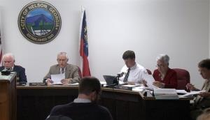 The Nelson, Ga. City Council meets to vote on a mandatory gun ownership ordinance for all heads-of-household.