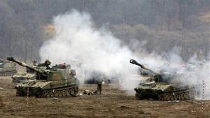 South Korean marines take part in a military exercise in the border city between the two Koreas yesterday.