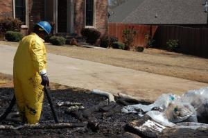 A worker cleans up oil in Mayflower, Ark., on Monday, April 1, 2013.