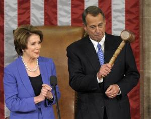 House Minority Leader Nancy Pelosi applauds after handing the gavel to House Speaker John Boehner on Jan. 3, 2013.