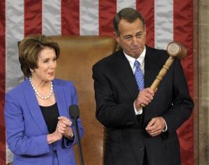 House Minority Leader Nancy Pelosi applauds after handing the gavel to House Speaker John Boehner on Jan. 3, 2013.