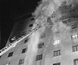 In a Dec. 20, 1970, file photo Tucson firefighters apply a steady stream of water during the Pioneer International Hotel fire.