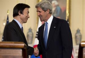 Secretary of State John Kerry shakes hands with South Korean Foreign Minister Yun Byung-Se at the State Department.