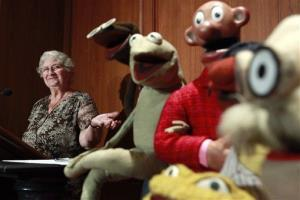 In this Aug. 25, 2010 photo, Jane Henson donates some of Jim Henson's early puppets, including the original Kermit, to the Smithsonian Institution.