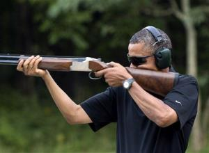 President Barack Obama shoots clay targets on the range at Camp David.