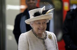 Britain's Queen Elizabeth II smiles as she visits Baker Street underground station in London, Wednesday, March 20, 2013.