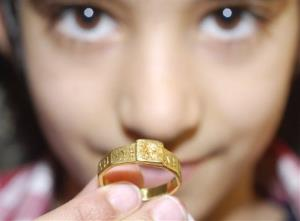 This is a National Trust handout photo of a Roman gold ring that could have inspired JRR Tolkien to write The Hobbit and The Lord of the Rings. It is on display in England.