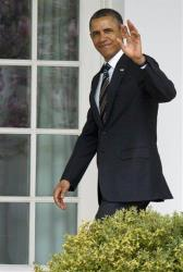 President Obama waves as he enters the Oval Office on Monday.