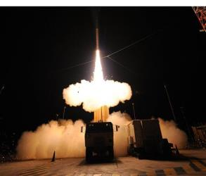 In this 2010 photo provided by the U.S. Missile Defense Agency, a Terminal High Altitude Area Defense (THAAD) interceptor missile is launched during the system's first operational test in Hawaii.