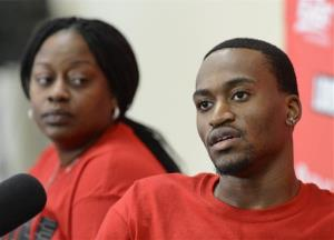 Louisville basketball player Kevin Ware answers questions as his mother, Lisa Junior, looks on during an interview Wednesday in Louisville, Ky.