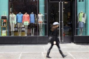 In this Tuesday, March 19, 2013 file photo,  a woman walks past the Lululemon Athletica store at Union Square in New York.