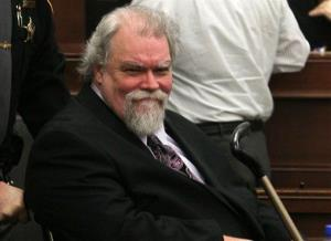In this Feb 27, 2013 file photo, Richard Beasley smiles at sister Sherri Beasley as he is wheeled into Summit County courtroom in Akron, Ohio.
