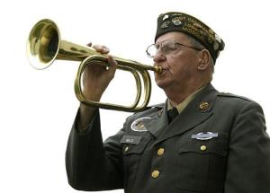 Loyd Welte, retired Army veteran, plays Taps with his bugle at a commemoration ceremony for Veteran's Day on Nov. 11, 2007 in Kirksville, Mo.