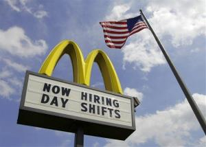 This May 2, 2012, file photo shows a sign advertising job openings outside a McDonalds restaurant in Chesterland, Ohio.