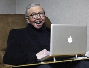 In this photo taken Jan. 12, 2011, Roger Ebert works in his office at the WTTW-TV studios in Chicago.