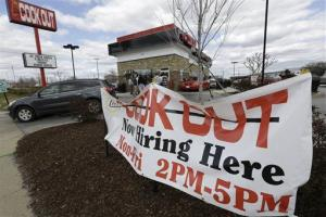 This  Friday, March 29, 2013, photo, shows a help wanted sign in front of a restaurant in Richmond, Va.