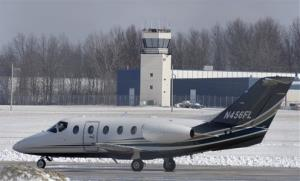A plane heads to the runway at the Cuyahoga County Airport Friday in Highland Heights, Ohio.
