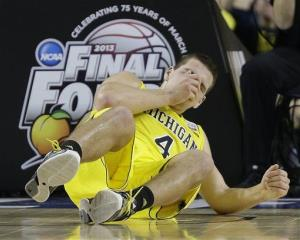 Michigan's Mitch McGary hits the floor during the second half.