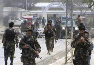 Afghan National Army soldiers rush to the scene moments after a car bomb exploded in front the Provincial Reconstruction Team, in Qalat, Zabul province, southern Afghanistan, Saturday, April 6, 2013.