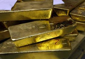 In this May 13, 2008 file photo, gold standard bars are piled up at the gold smelter company Argor-Heraeus in Mendrisio, Switzerland.