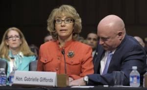In this Jan. 30, 2012 file photo, Gabrielle Giffords is aided by husband Mark Kelly as she speaks before the Senate Judiciary Committee hearing on gun violence.