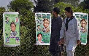 Pakistanis look at posters of former military ruler Gen. Pervez Musharraf along a roadside on the outskirts of Islamabad, Pakistan on Sunday, April 7, 2013. Musharraf was given approval on Sunday to run for parliament in a remote northern district after being rejected in two other parts of the country,...