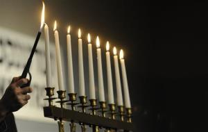 The last candle is lit during a Holocaust memorial service.