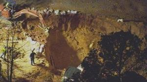 In this image made from video and provided by WSOC-TV Charlotte, authorities work to rescue two children at a construction site, Sunday, April 7, 2013, in Stanley, NC.