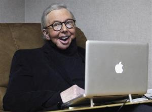 In this Jan. 12, 2011 file photo, movie critic Roger Ebert works in his office at the WTTW-TV studios in Chicago.