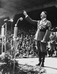 Adolf Hitler gestures during a speech in May 1937 at an unknown location in Germany.