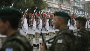 Greek Presidential guards march during a military parade commemorating Greece's entry in World War II in 1940, in the northern city of Thessaloniki, Sunday, Oct. 28, 2012.