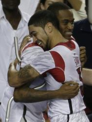 Injured Louisville player Kevin Ware, left, hugs teammate Peyton Siva after the game.