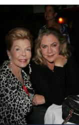 In happier times, philanthropist Lois Pope, left, celebrates the publication of her son's book, The Deeds of My Fathers, with actress Kathleen Turner.