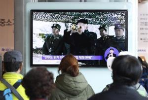 People watch a TV program showing North Korean leader Kim Jong Un at Seoul Railway Station Sunday, April 7, 2013.