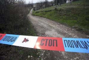 Police tape is seen on the road near a house in the village of Velika Ivanca, Serbia this morning.