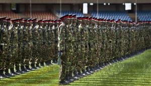 Members of the Kenyan military parade as they practice ahead of the presidential inauguration which is due to take place on Tuesday, at the Kasarani stadium near Nairobi, Kenya, Friday, April 5, 2013.