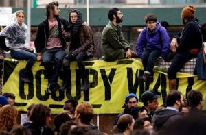 Occupy Wall Street protesters regroup in Duarte Park Tuesday, Nov. 15, 2011 in New York after they were forced to leave and their encampment was taken down in Zucotti Park.