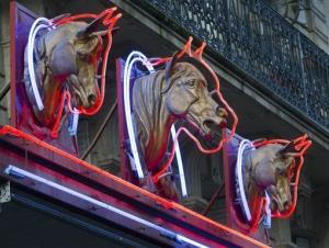 3 statues of horses' heads,  above a horsemeat butcher shop  in Paris, Friday, Feb 15, 2013.