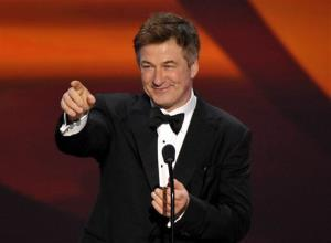 This Jan. 27, 2013 file photo shows Alec Baldwin presenting the Screen Actors Guild Life Achievement Award to Dick Van Dyke at the 19th Annual SAG Awards at the Shrine Auditorium in Los Angeles.