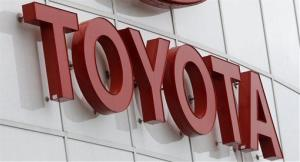 In this March 30, 2011 photo, a portion of the Toyota logo is shown at Wilsonville Toyota, in Wilsonville, Ore.