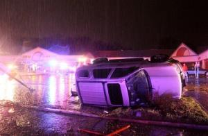 A car lies on its side in Hazelwood after a storm blew through the area on Wednesday, April 10, 2013.