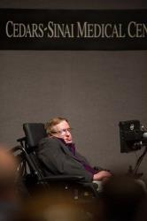 British cosmologist Stephen Hawking gives a talk to workers at Cedars-Sinai Medical Center in Los Angeles on April 9, 2013.