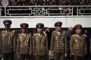 Military officers stand ready at a stadium in Pyongyang, North Korea, Friday, April 12, 2013.