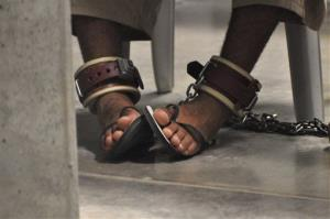 A Guantanamo detainee's feet are shackled to the floor as he attends a Life Skills class inside the Camp 6 high-security detention facility on Guantanamo Bay U.S. Naval Base.
