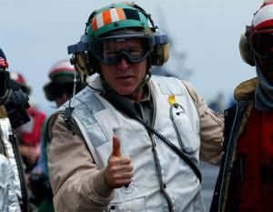 George W. Bush gives a thumbs up as he visits the aircraft carrier USS Abraham Lincoln off the California coast on Thursday, May 1, 2003.