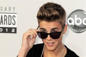 In this Nov. 18, 2012 file photo, Justin Bieber arrives at the 40th Anniversary American Music Awards in Los Angeles.