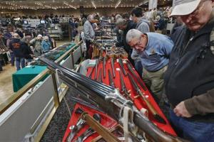 In this Saturday, Jan. 26, 2013 file photo, gun enthusiasts gather during the annual New York State Arms Collectors Association Albany Gun Show.