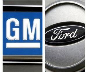 In this combo made with file photos, logos for General Motors and Ford are shown.