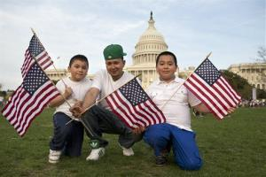 Josue Benavides, 28, center, who is originally from El Salvador, poses for a portrait with his cousins  fter attending the Rally for Citizenship, in support of immigration reform last week.