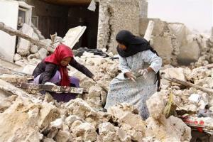 Survivors search the rubble, a day after an earthquake, at the city of Shonbeh, southern Iran, Wednesday, April 10, 2013.
